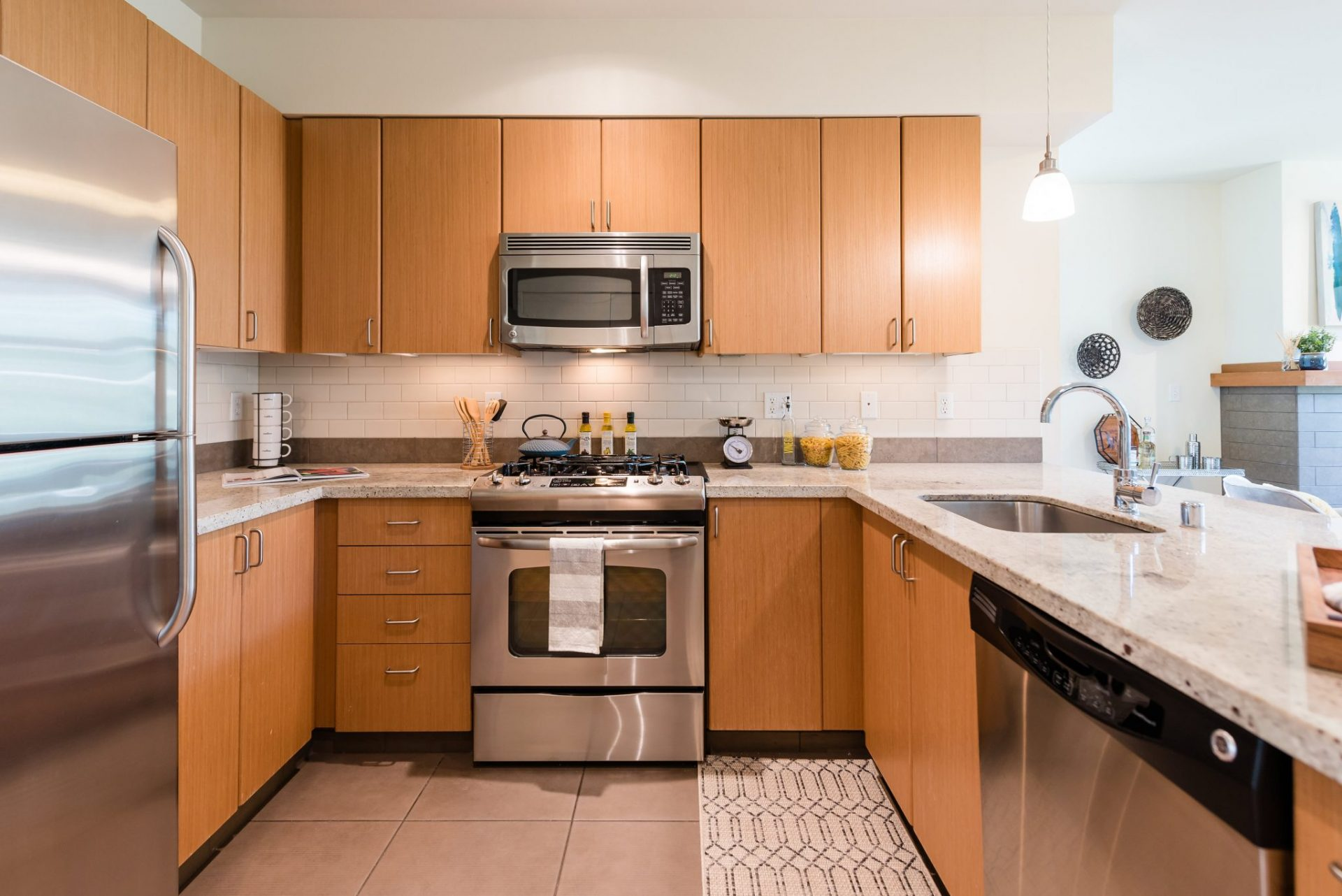 Modern Kitchens With Stainless Steel Appliances At Thornton Place Apartments In Seattle, WA