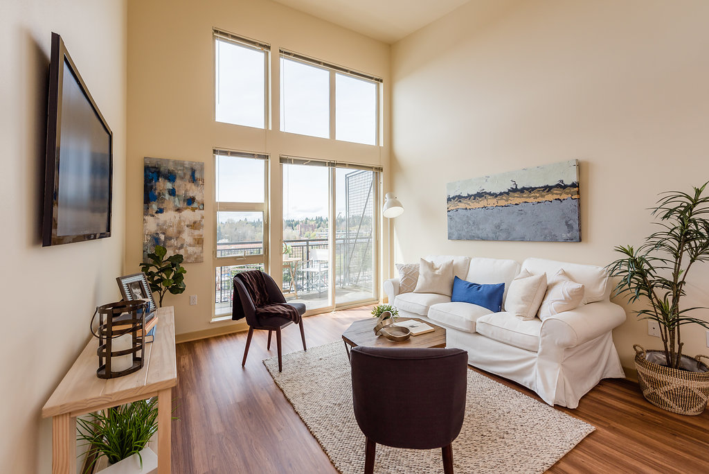 Spacious Living Rooms With Ample Natural Lighting At Thornton Place Apartments In Seattle, WA