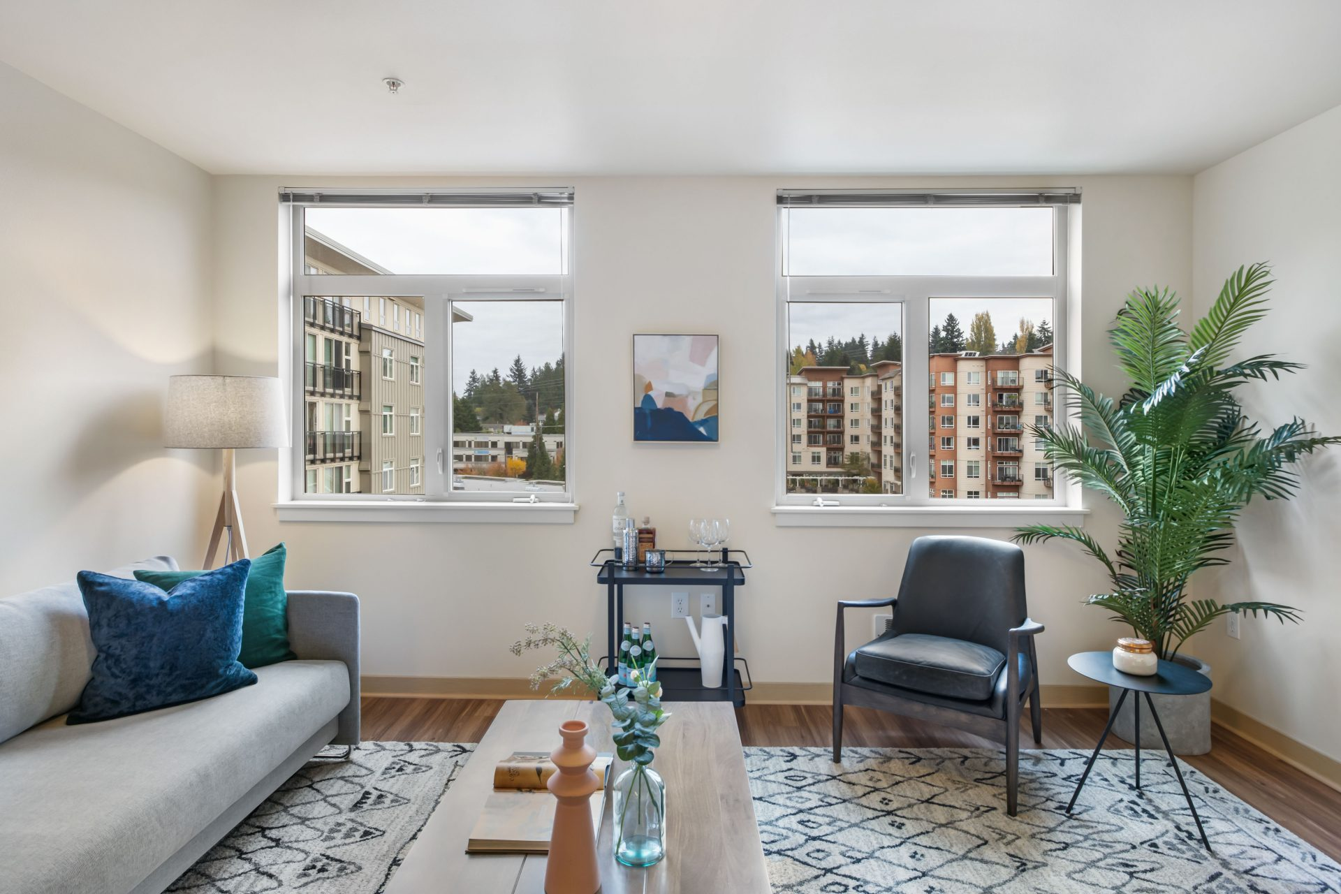 Well lit living space with view of Seattle