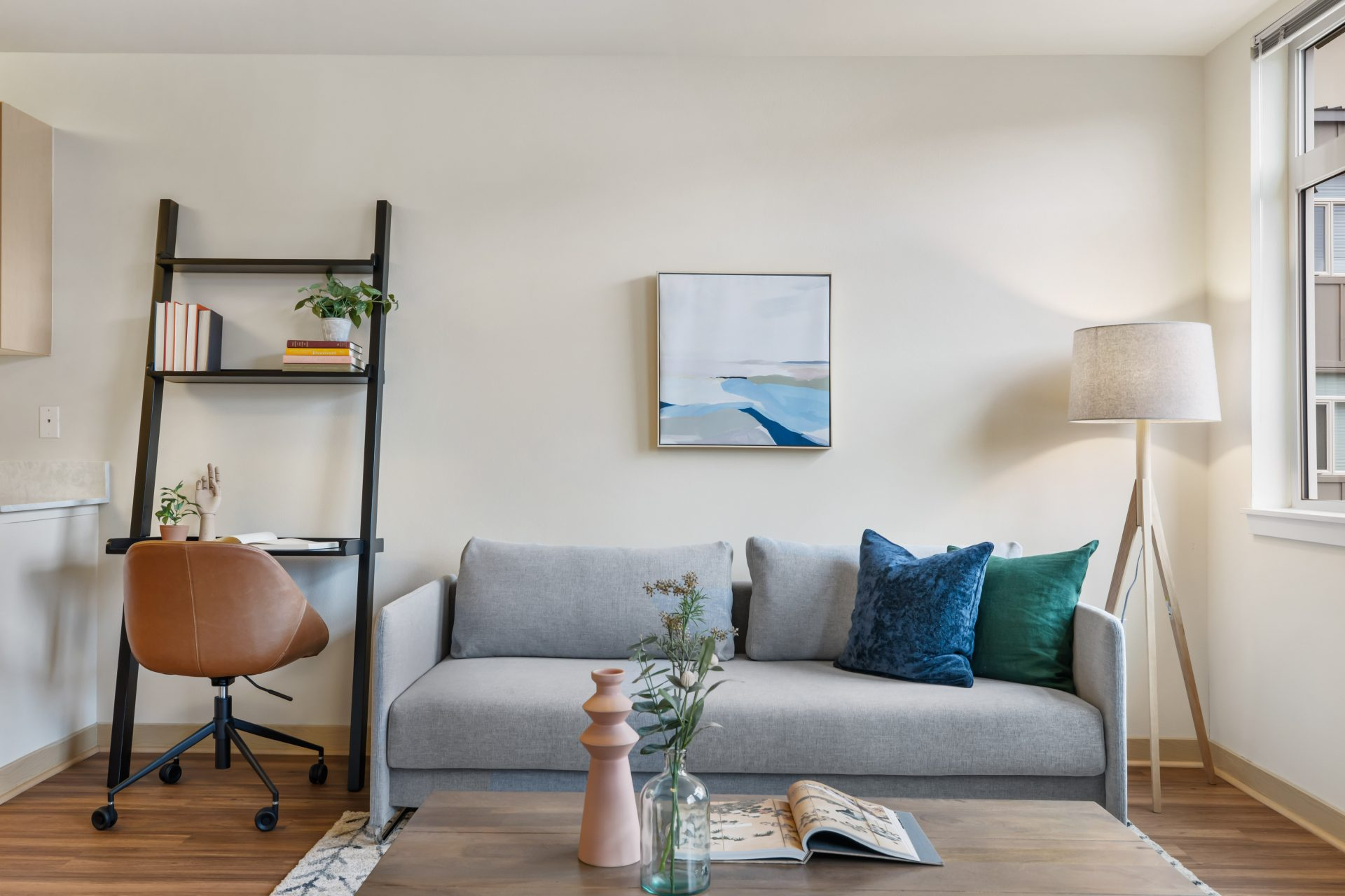 modern living space with plank wood flooring at Thornton Place in Seattle